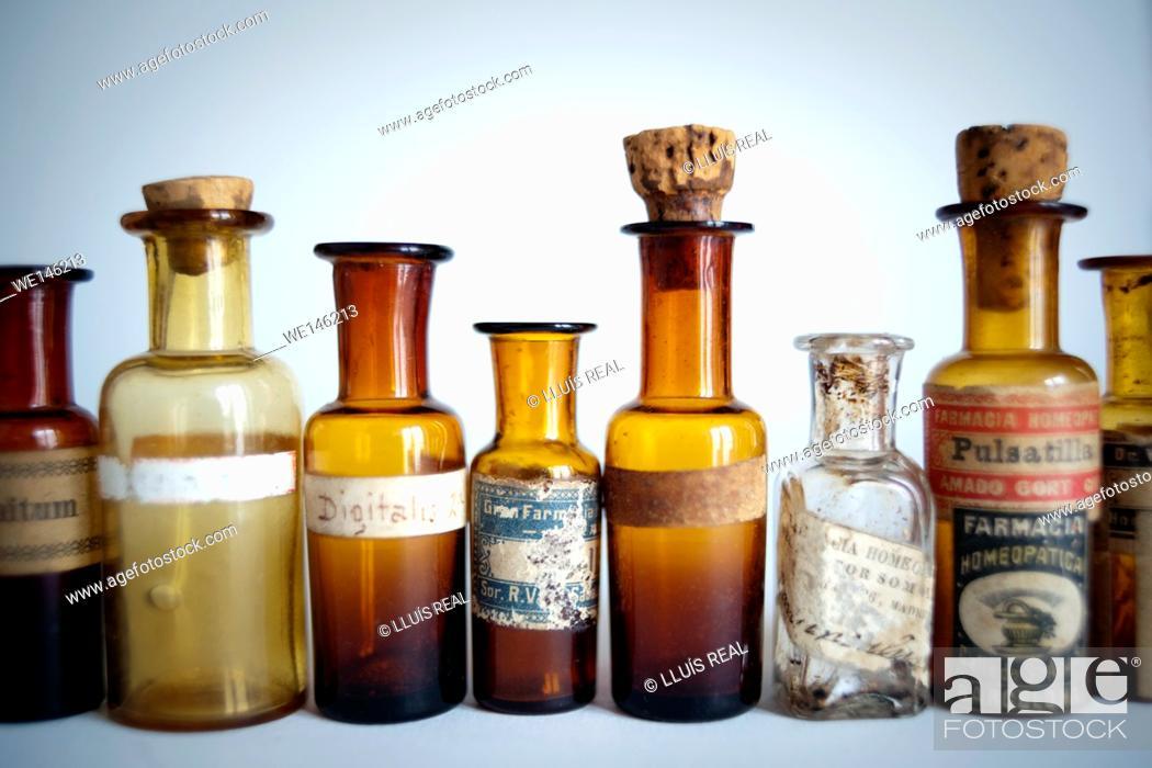 Stock Photo: grupo de botellas de medicamento homeopatico, group of bottles of homeopathic medicine.