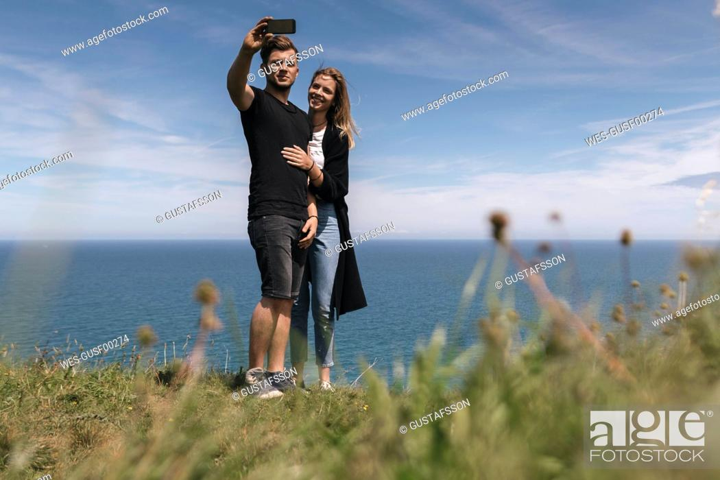 Stock Photo: Young couple making a selfie.