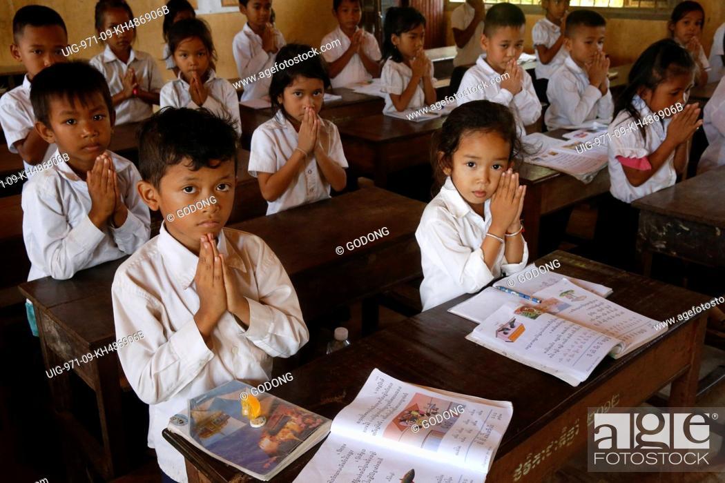 Stock Photo: Cambodian schoolchildren saluting. Battambang. Cambodia.