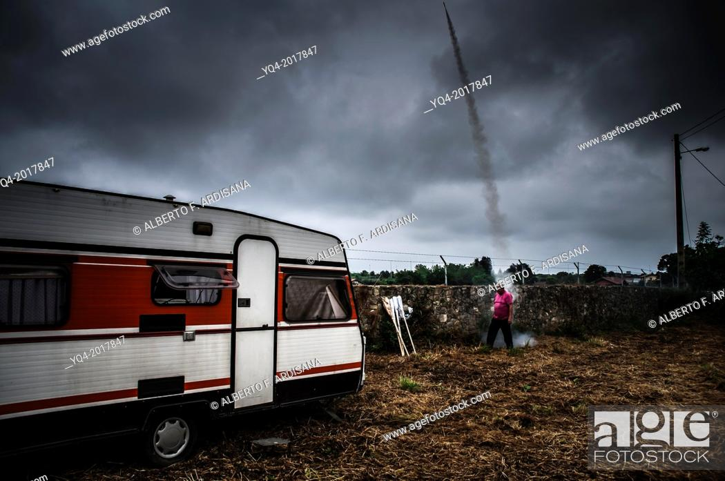 Stock Photo: A man pulling rockets to announce the passage of the procession. Ships Llanes.Asturias. Spain.