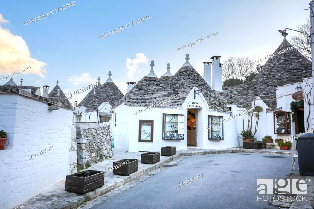 Stock Photo: Characteristic houses named Trulli located at mid of Puglia land. Alberobello, Puglia. Italy.