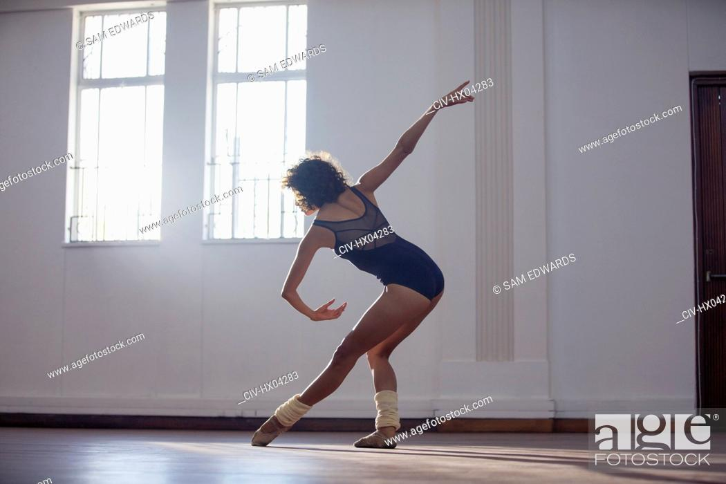Stock Photo: Graceful young female dancer practicing in dance studio.