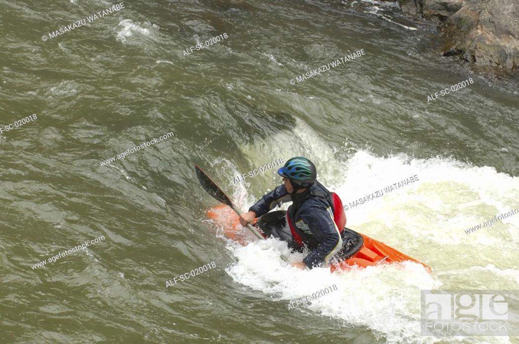 Stock Photo: Kayaker Negotiating the River.