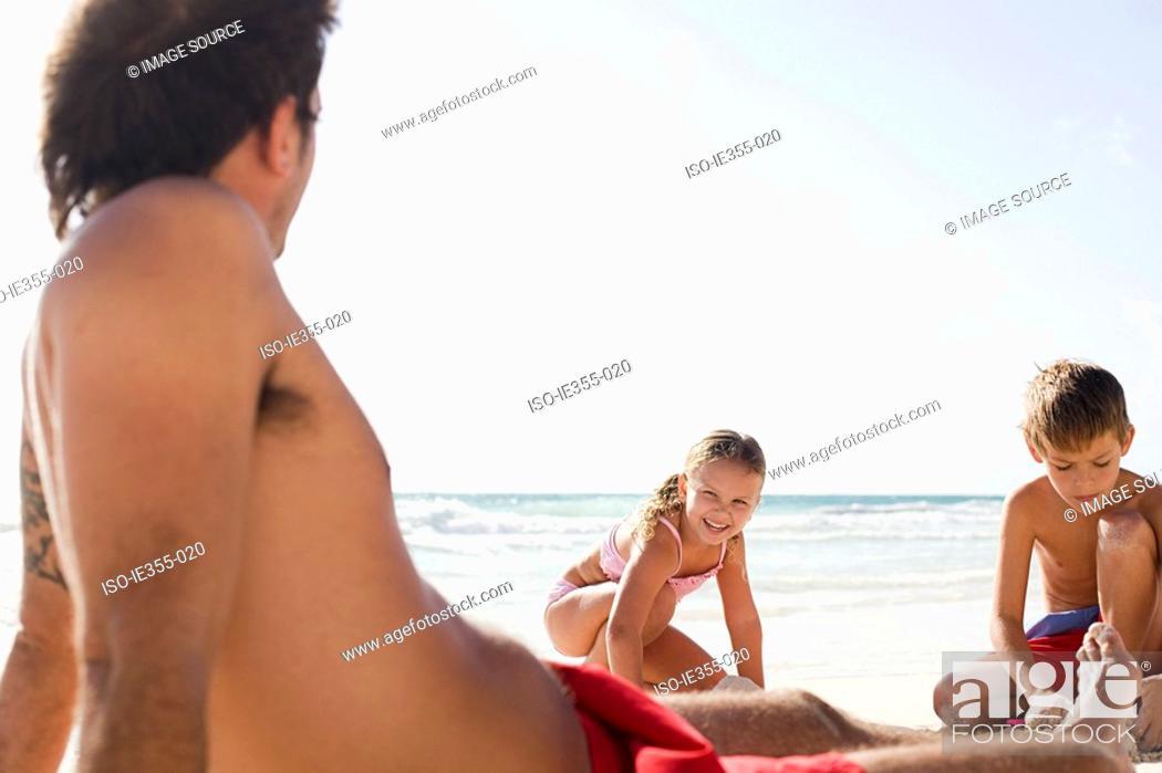 Stock Photo: A family on a beach.