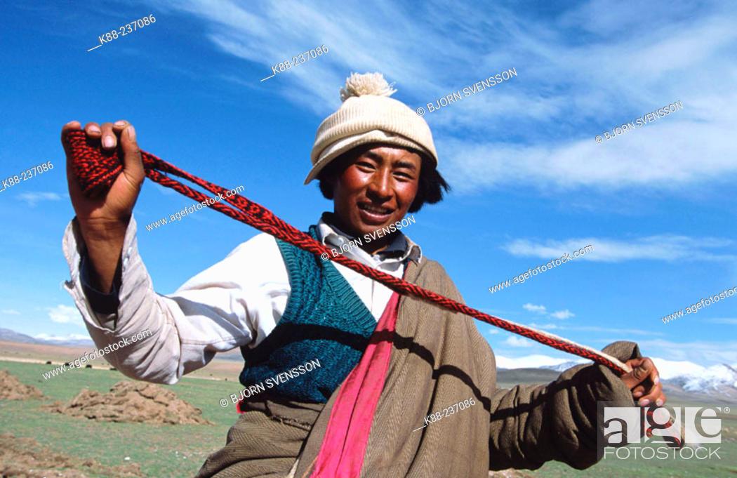 Stock Photo: Nomad man with catapult. Nam Tso Lake. Tibet.