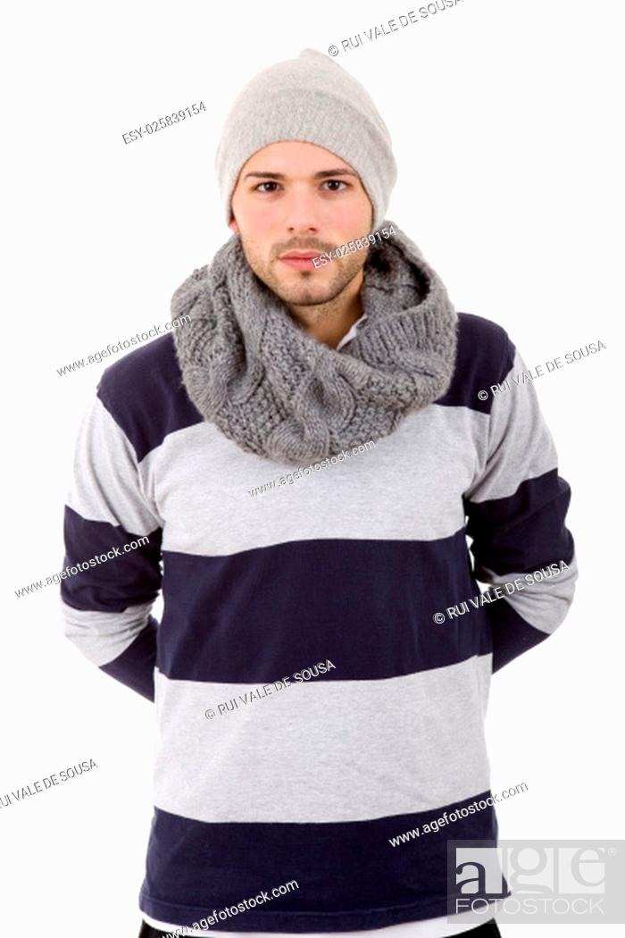 Stock Photo: studio picture of a young man dressed for winter.