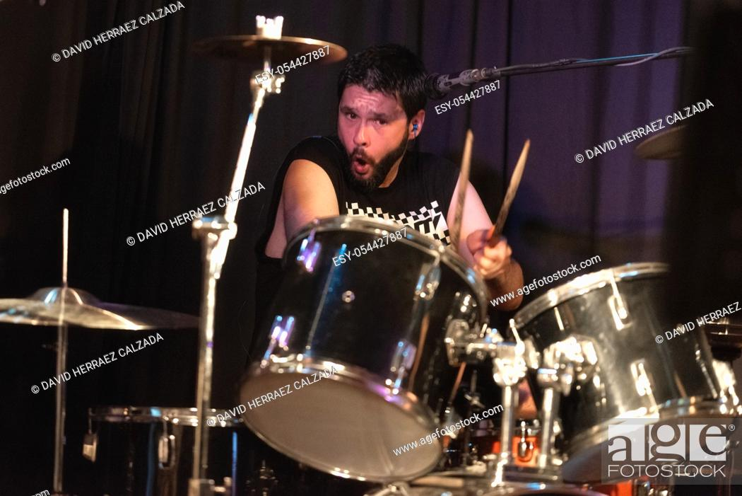 Stock Photo: Male Musician Playing Drums And Cymbals At Concert .