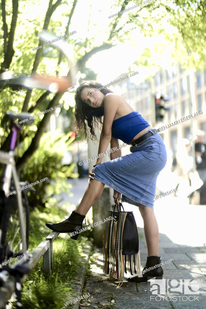 Stock Photo: Young woman on the street. Munich, Germany.