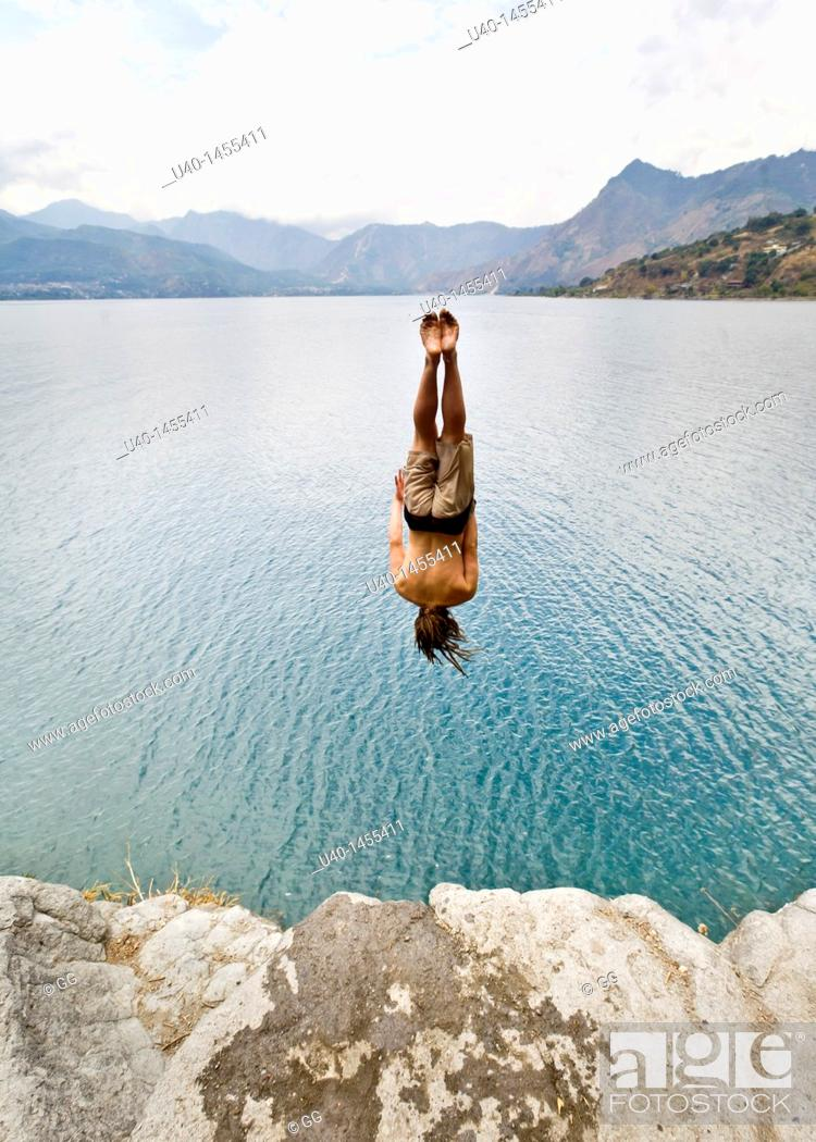Stock Photo: Guatemala, San Marcos La Laguna, man jumping off cliff.