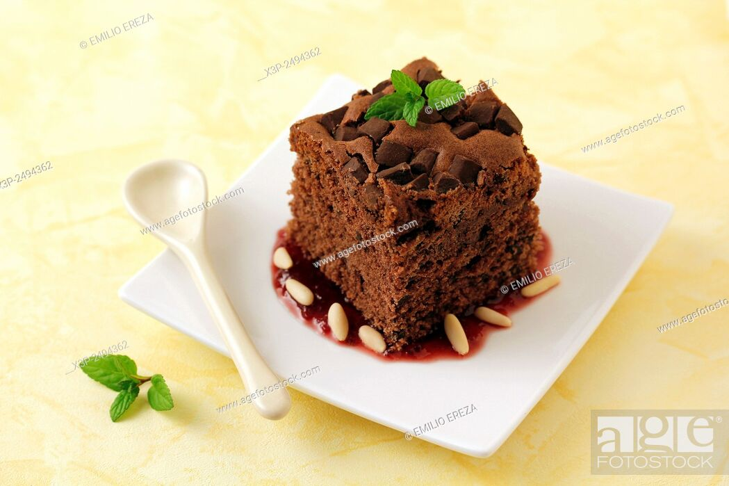 Stock Photo: Brownie with cherries jam and pine nuts.