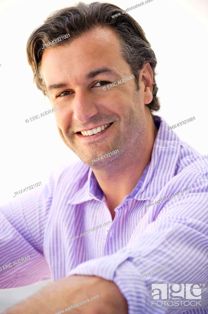 Stock Photo: Portrait of a mid adult man smiling.