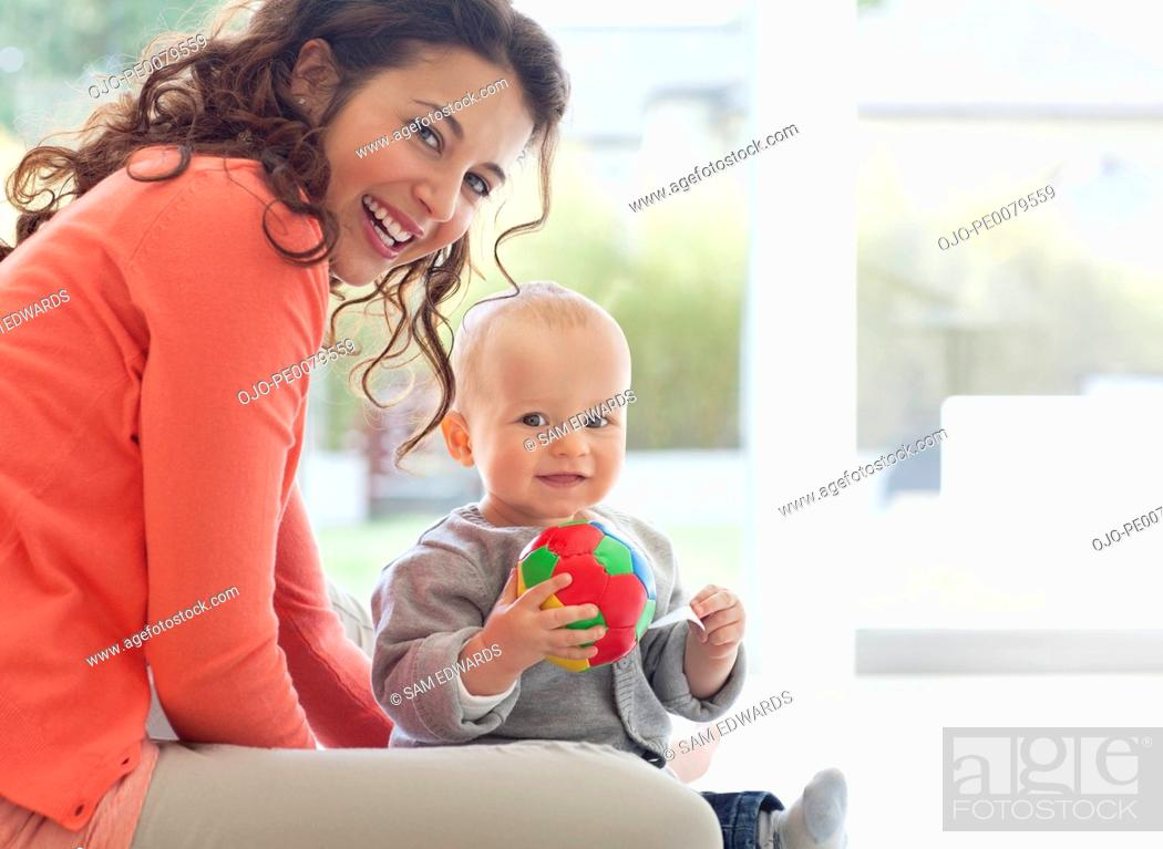 Stock Photo: Mother and baby playing with ball.