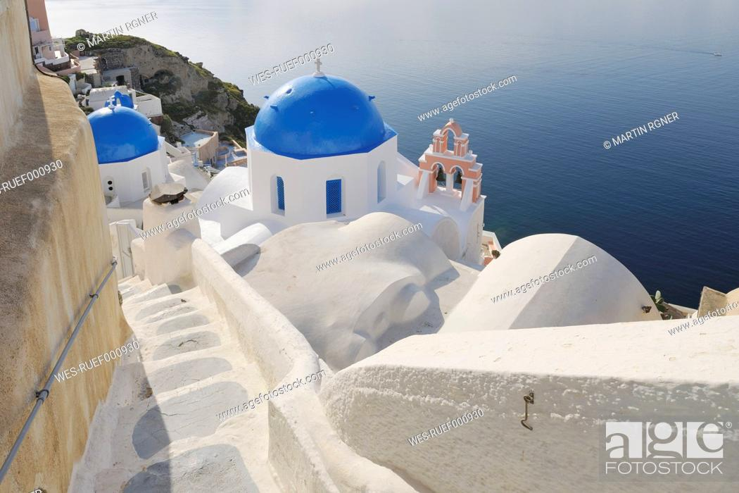 Stock Photo: Greece, View of whitewashed church and bell tower at Oia village.