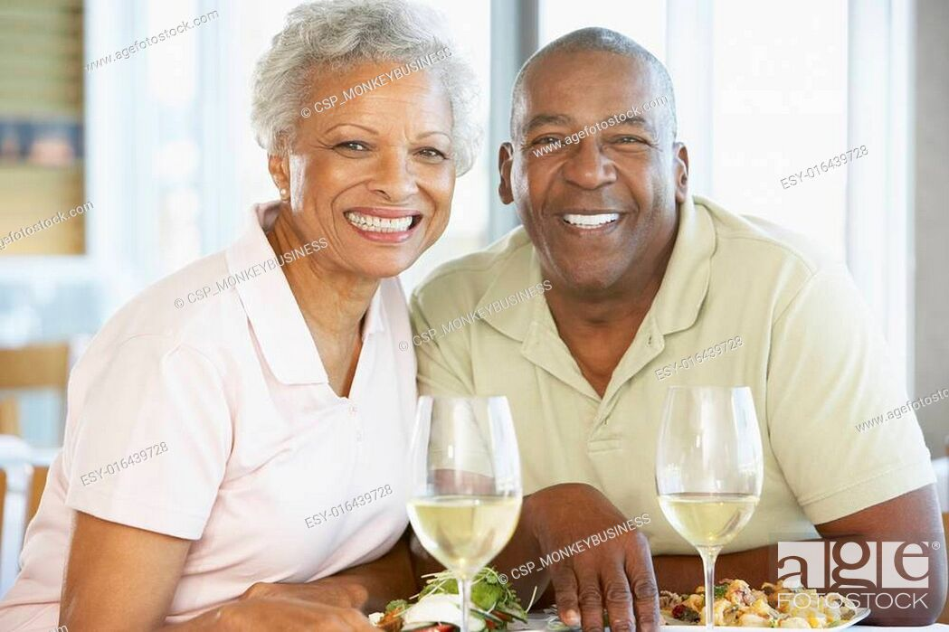Stock Photo: Senior Couple Having Lunch Together At A Restaurant.