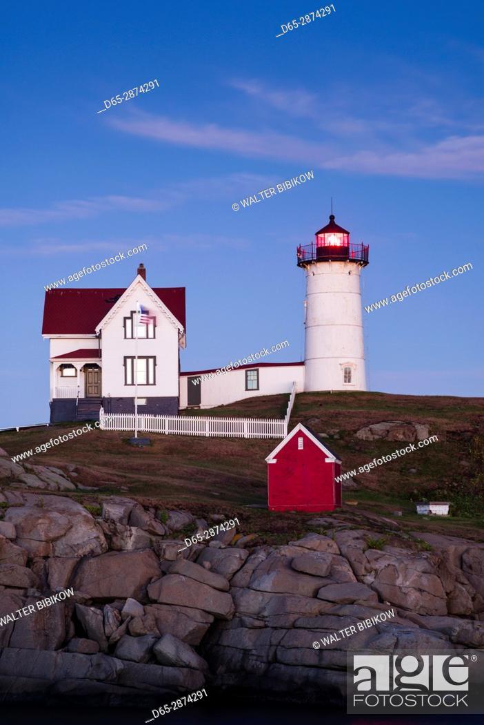 Stock Photo: USA, Maine, York, Nubble Light Lighthouse, dusk.
