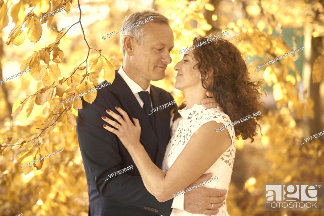 Stock Photo: Just married couple between autumn leaves, Starnberg, Bavaria, Germany.