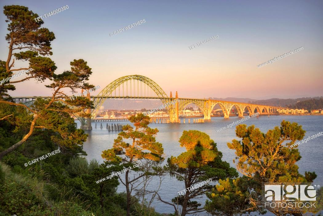 Stock Photo: USA, Oregon, Newport, Bridge over river at sunset.