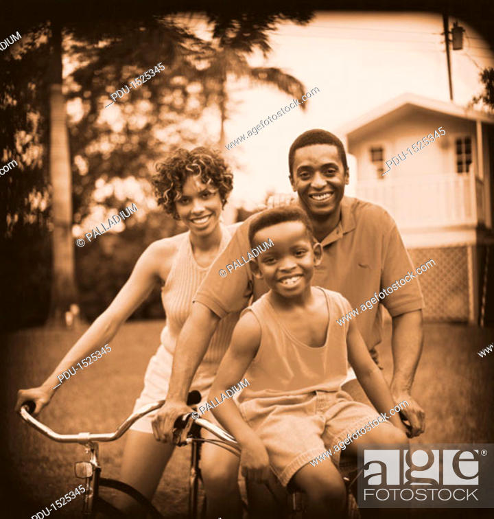 Stock Photo: view of a mother and father out cycling with their son.