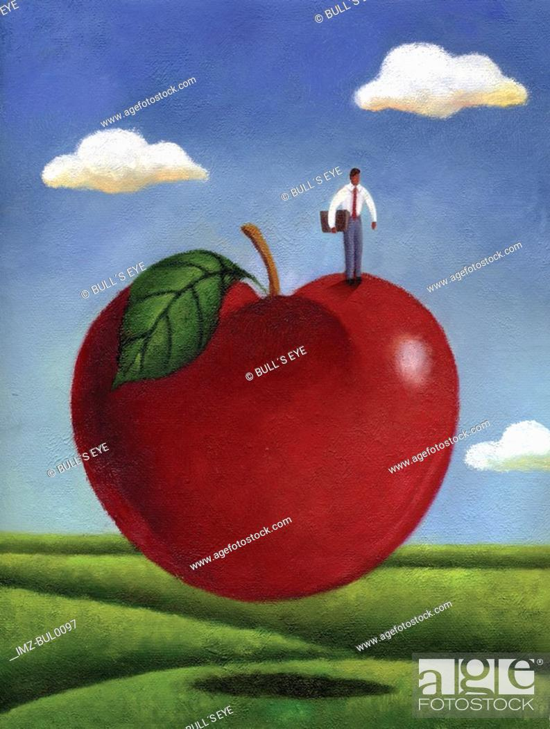 Stock Photo: Businessman standing on a giant red apple.