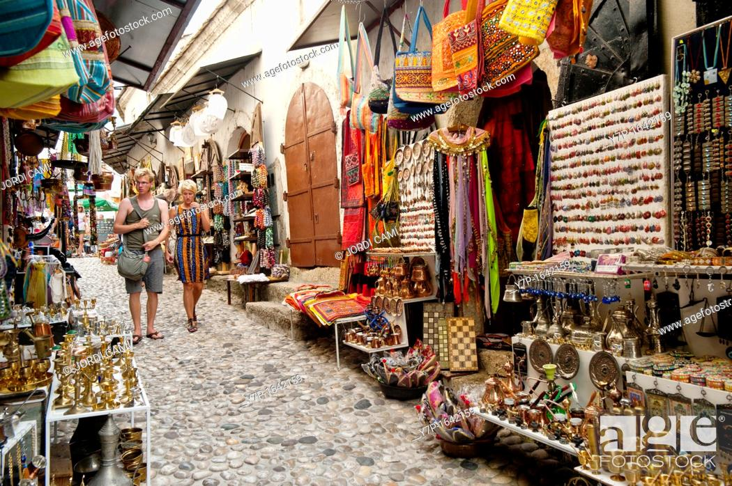 Stock Photo: Souvenirs shops in a cobbled street known as Kujundziluk in Mostar old town Bosnia- Herzegovina  Balkans Europe.