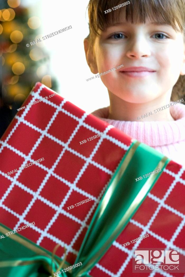 Stock Photo: girl with christmas box.