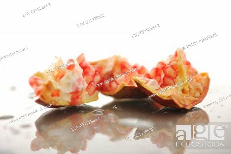 Stock Photo: Pomegranate with reflection.