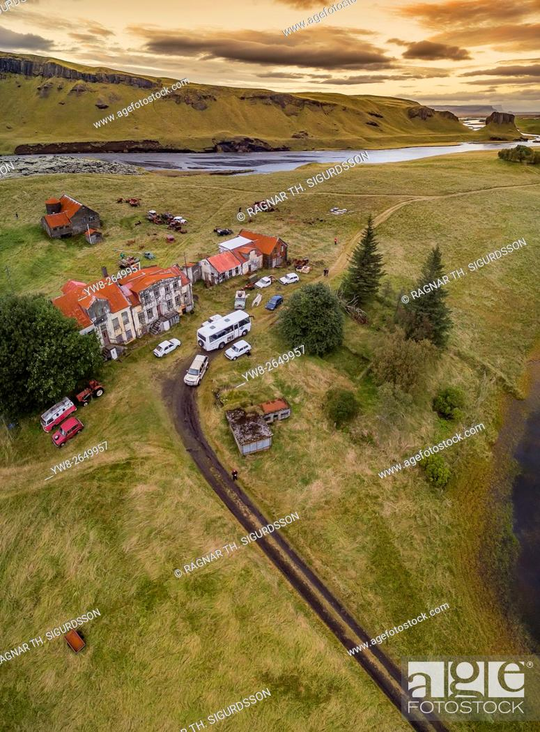 Stock Photo: Old farm and cars decaying, Holmur Farm near Kirkjubaejarklaustur, Iceland. This image is shot using a drone.