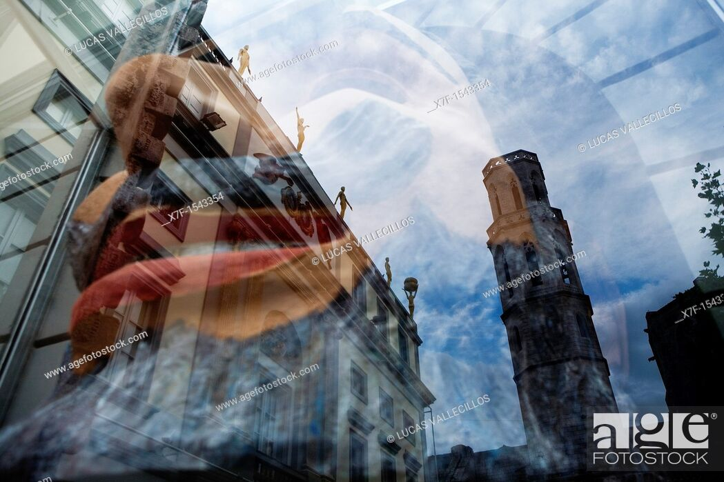 Stock Photo: Church of Sant Pere Reflected in a Shop window of Dalí's Theatre Museum, that houses a sculpture, Figueres.Girona province. Catalonia. Spain.