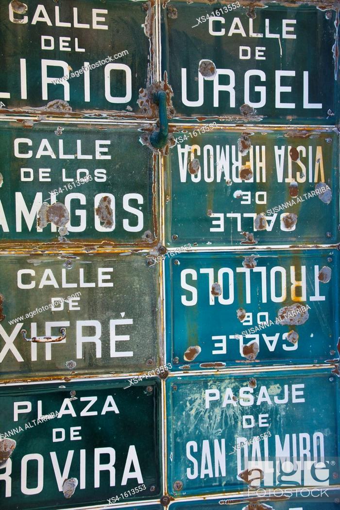 Stock Photo: Collection of street signs in a door in Porrera, Priorat, Tarragona, Spain, Europe.