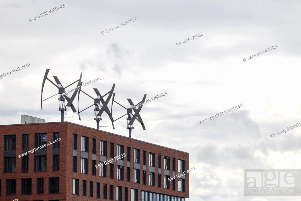 Stock Photo: Wind energy production atop a building in the HafenCity of Hamburg, Germany.