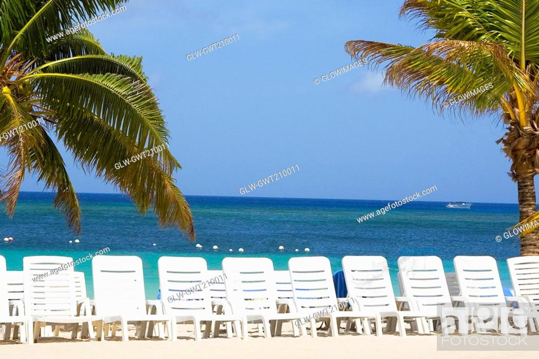 Stock Photo: Rear view of a woman standing on the beach, Honduras.