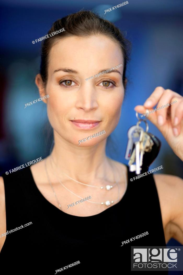Stock Photo: Portrait of a businesswoman holding keys.