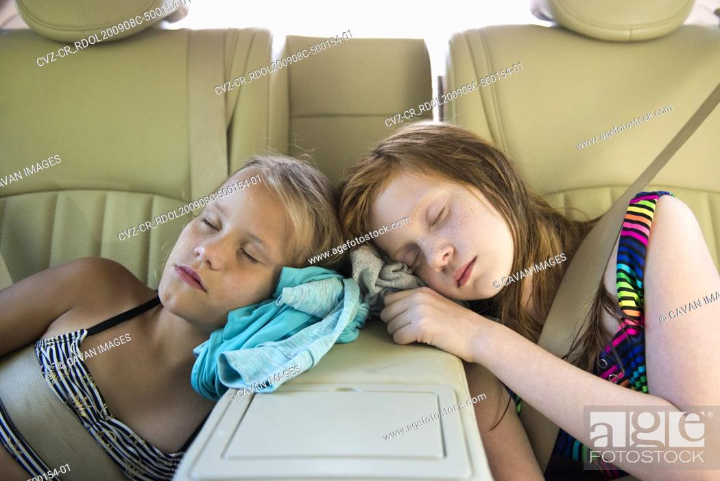 Stock Photo: Two Young Girls Asleep in Car After Playing.