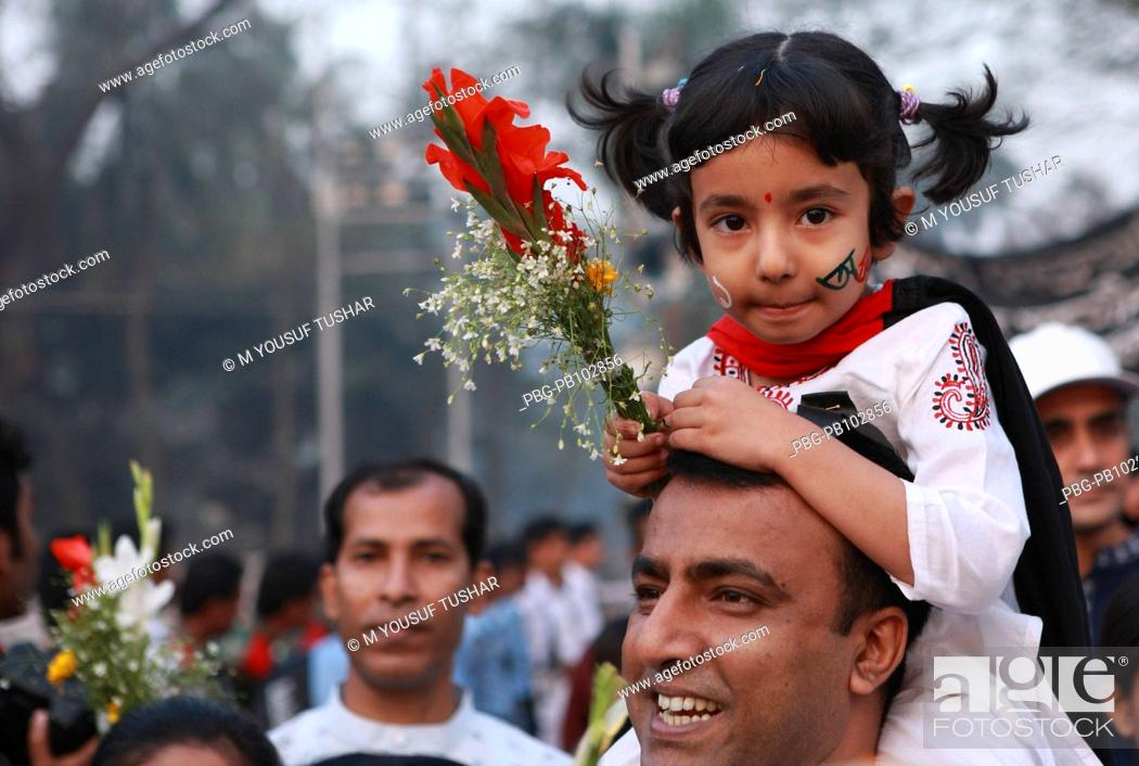 """Stock Photo: A girl child with his father arrives for place wreaths at the """"Central Shaheed Minar"""" Language Martyrs' Monument on the occasion of International Mother."""