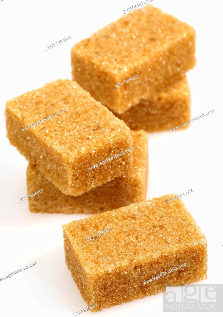 Stock Photo: Brown Sugar, Cubes against White Background.