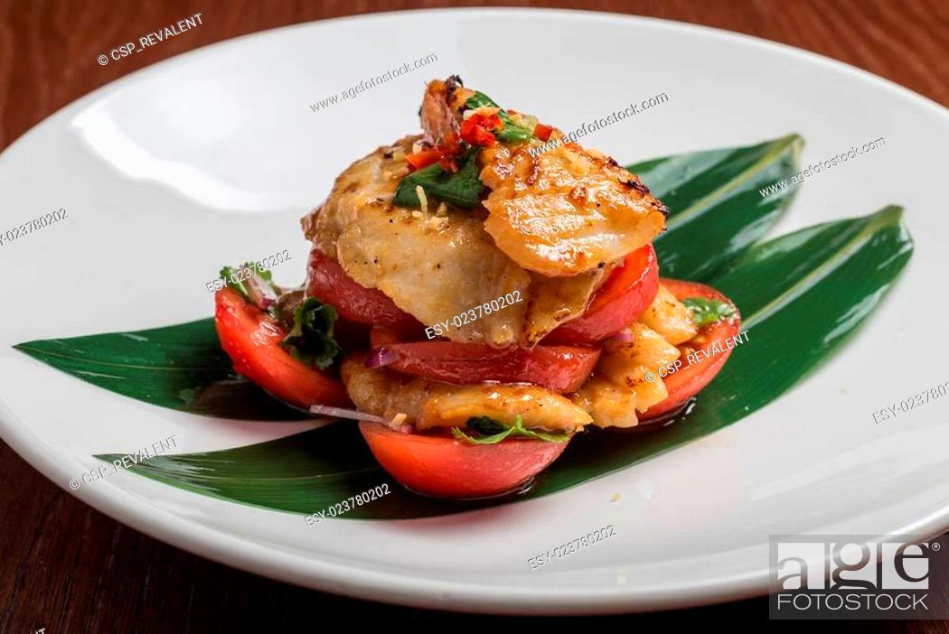 Stock Photo: codfish with tomatoes.