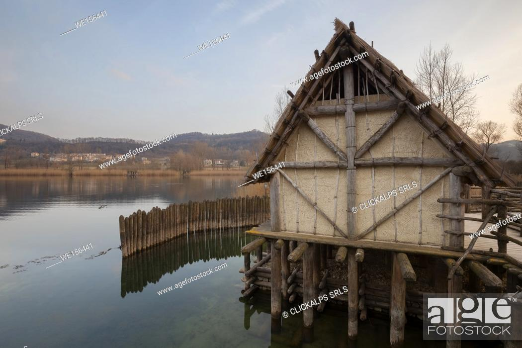 Stock Photo: On the shores of the lake of Lago is the Archeopark Livelet (archaeological park educational). The entire structure is built on stilts; in the area there are.