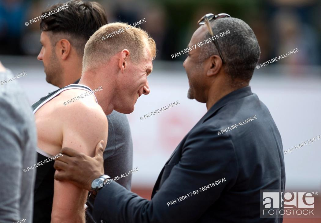 Stock Photo: 17 June 2018, Germany, Ratingen: Athletics: Mehrkampf-Meeting. Arthur Abele (L) of Germany is congratulated by DLV head coach Idriss Gonschinska after the.