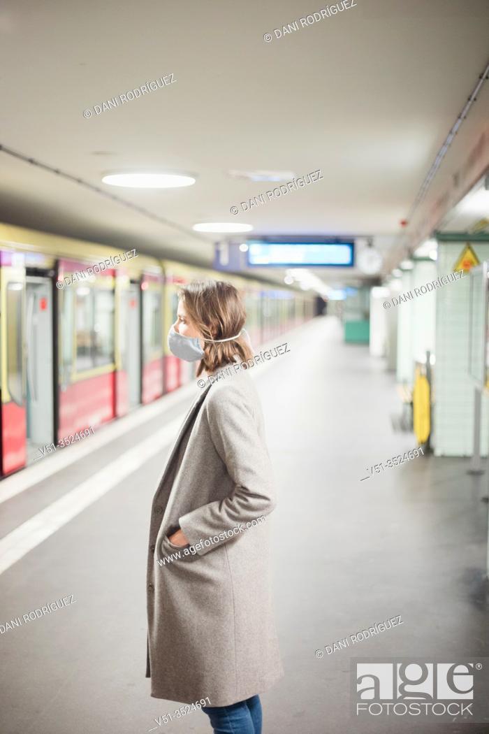 Stock Photo: Woman using public transportation with mask during Corona days.