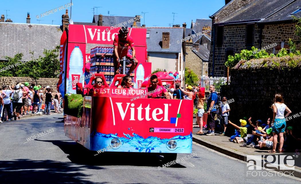 Stock Photo: The Tour de France 2015 - Stage 7 - Livarot (Normandy) to Fougères (Brittany) The Caravan passes through Lassay-les-Chateaux.