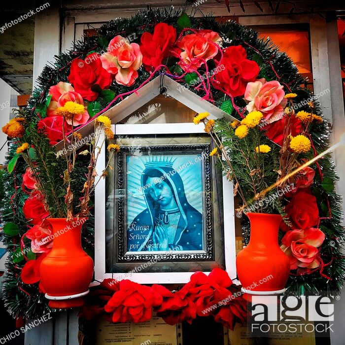 Stock Photo: An altar to Our Lady of Guadalupe decorates a street in Coyoacan, Mexico City, Mexico.