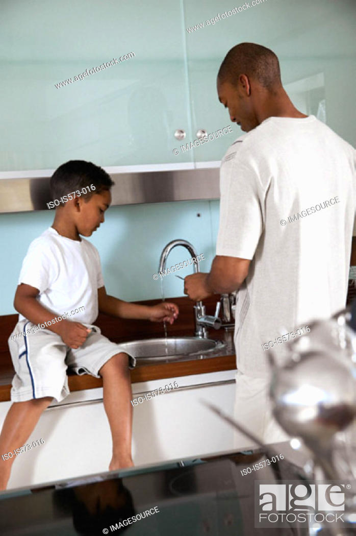 Stock Photo: Father and son in kitchen.
