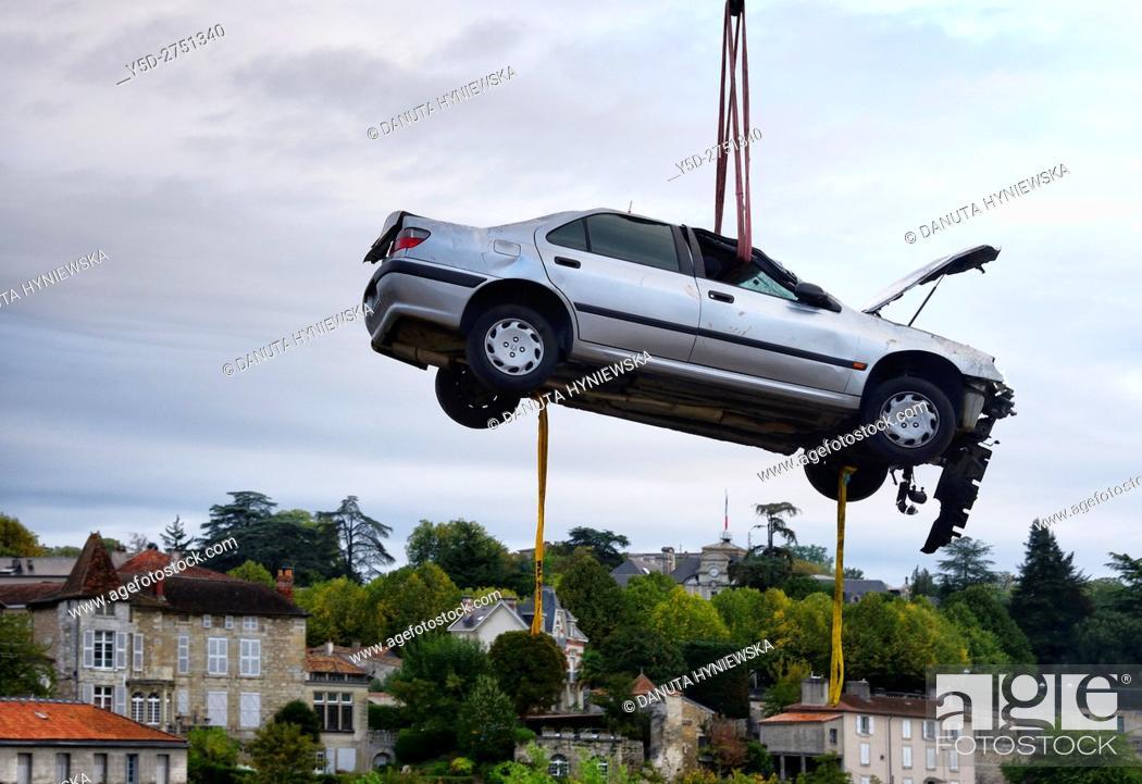 Imagen: crane lifting of crashed car, Perigueux, Aquitaine, France , Europe.