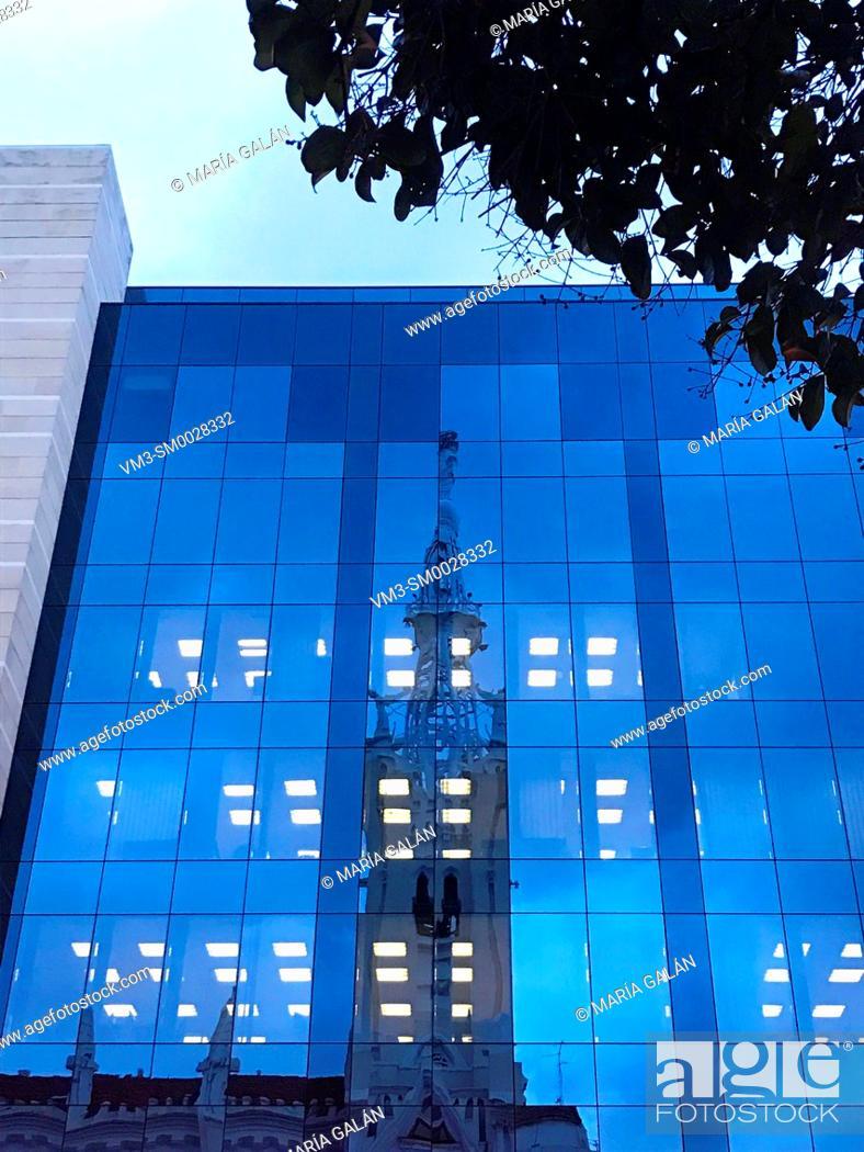 Stock Photo: Reflection on glass facade. Goya street, Madrid, Spain.