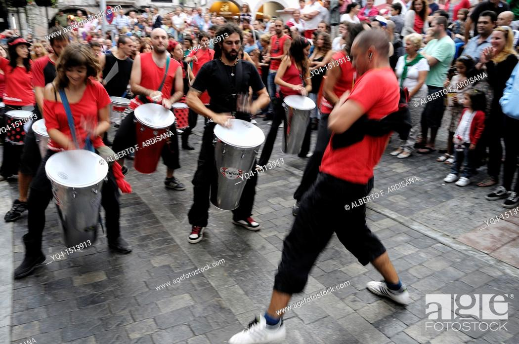 Stock Photo: Batucada. The percussion group Samba da rua performing in the streets of Llanes during the festival of San Roque 2011.