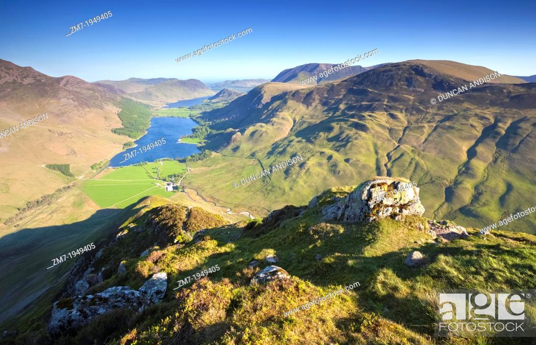 Stock Photo: Lake Buttermere at Sunrise from the summit of Fleetwith Pike in the Lake District, England, UK.