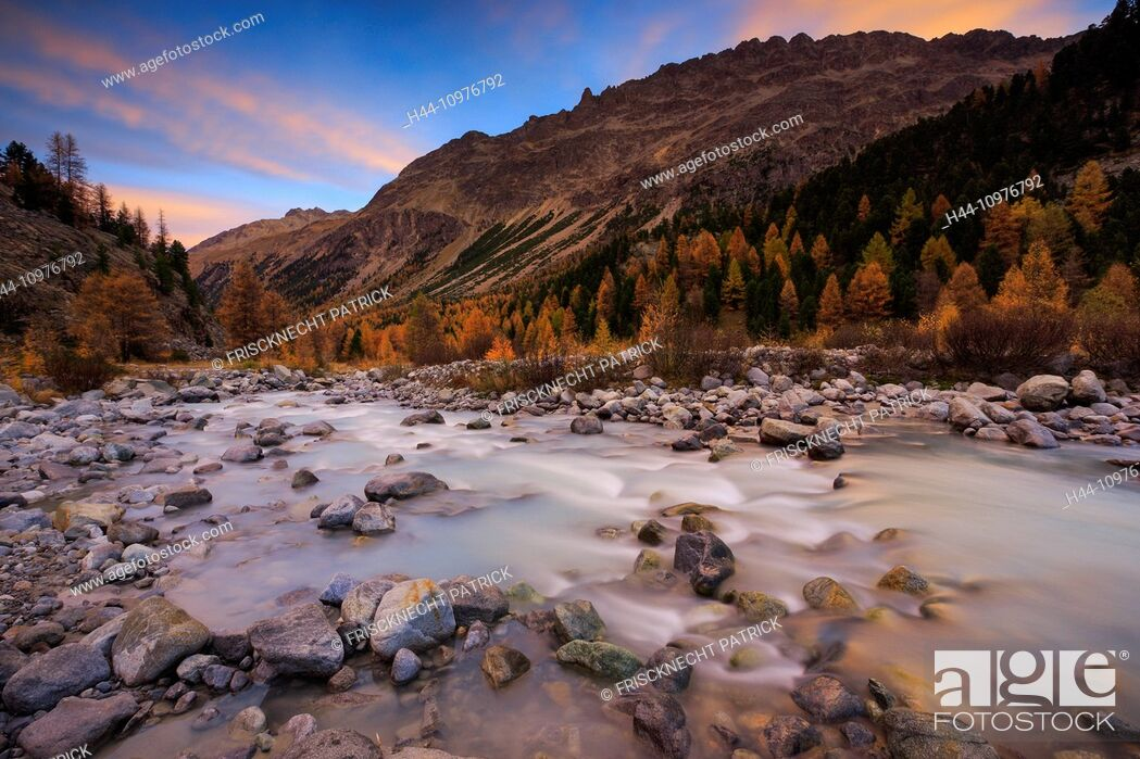 Stock Photo: Alpine, panorama, view, mountain, mountains, massif, cliff, river, flow, mountains, Graubünden, Grisons, autumn, colors, larch, larches, morning, daybreak.