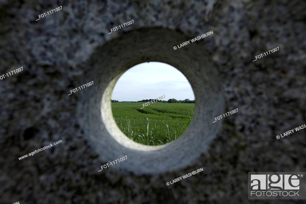 Stock Photo: A remote natural landscape seen through a hole in granite.