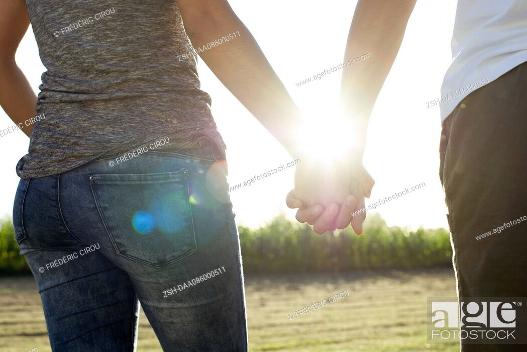 Stock Photo: Couple holding hands taking walk together.