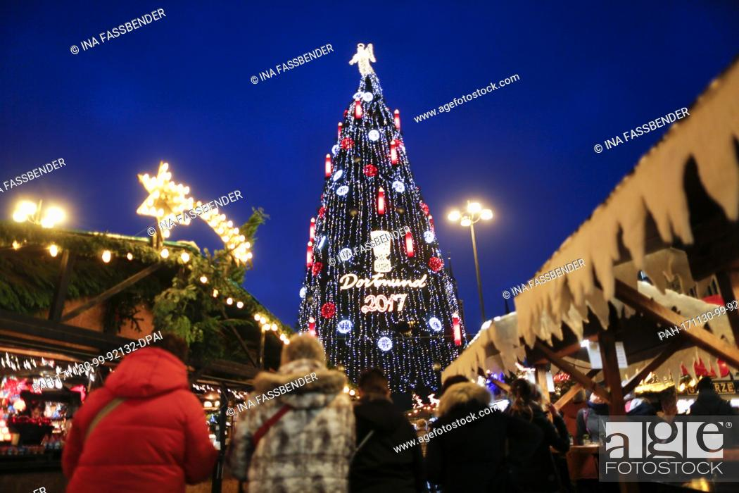 Stock Photo: dpatop - The according to the organisers biggest Christmas tree in the world illuminates the Christmas market in Dortmund, Germany, 30 November 2017.